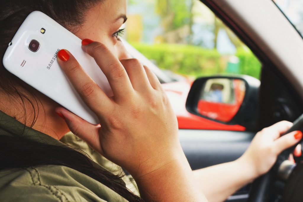 distracted driving woman on cellphone